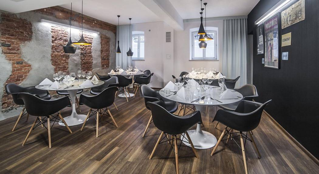 restaurant with black eames chairs | byBespoek