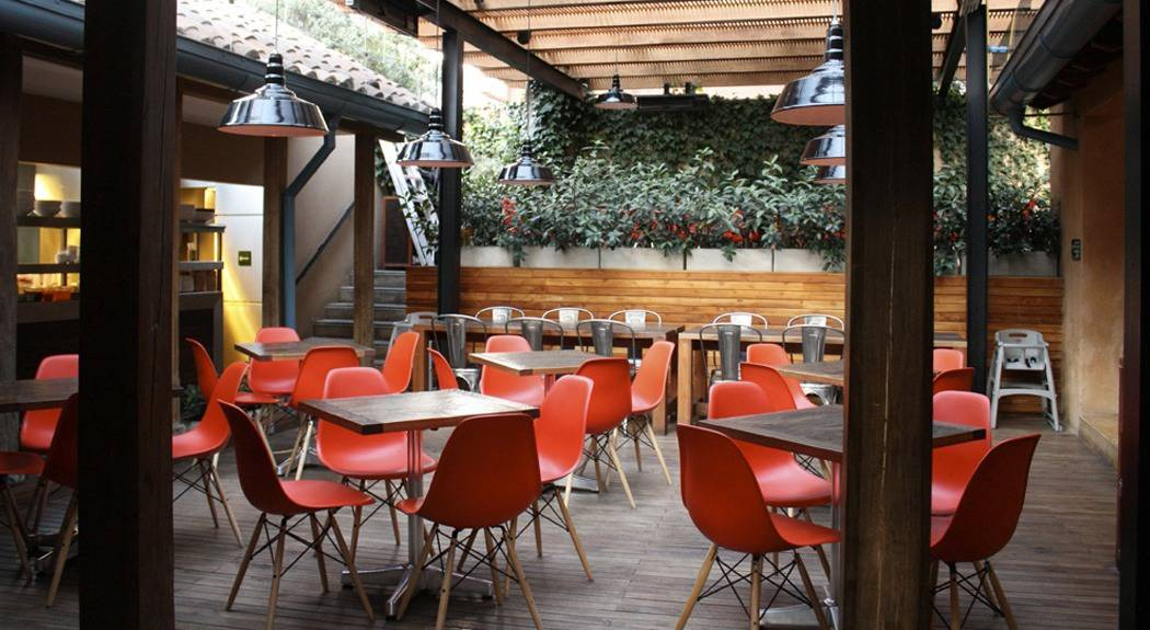 restaurant with red eames chairs | byBespoek