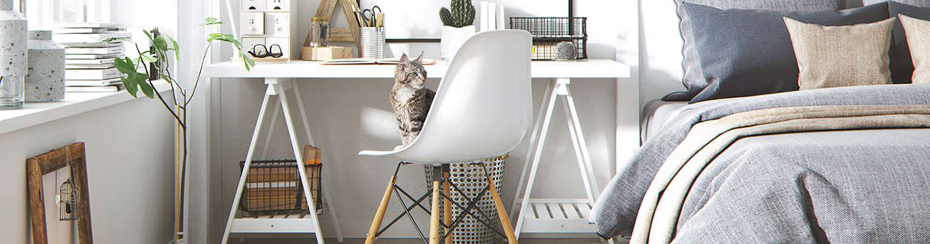 Eames chair beside bed with cat sitting on it - byBESPOEK