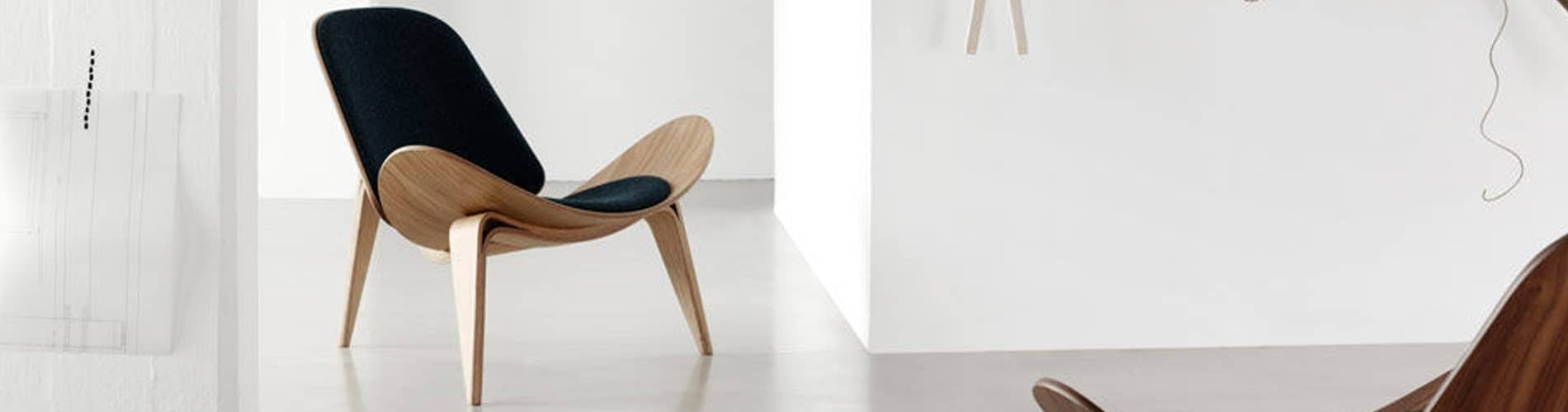 Hans Wegner shell chair (CH07) inside a room | byBespoek