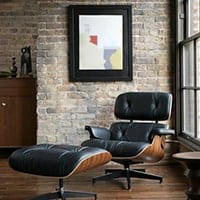 Eames Lounge Chair<br /><b>Walnut Wood + Black Leather</b>